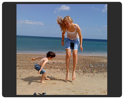 girl and boy playing on beach