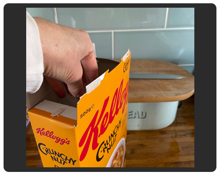hand and breakfast cereal