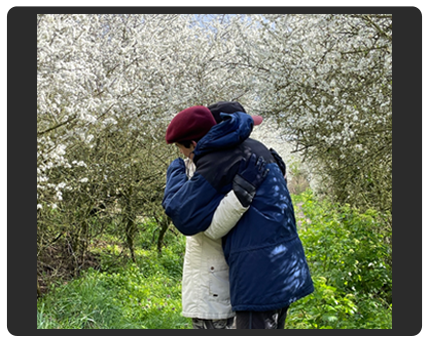 couple embracing under blossoming trees